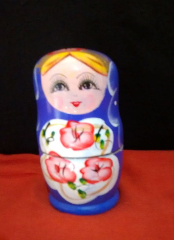 A handcrafted Wooden matryoshka doll family in by PattachitraNet
