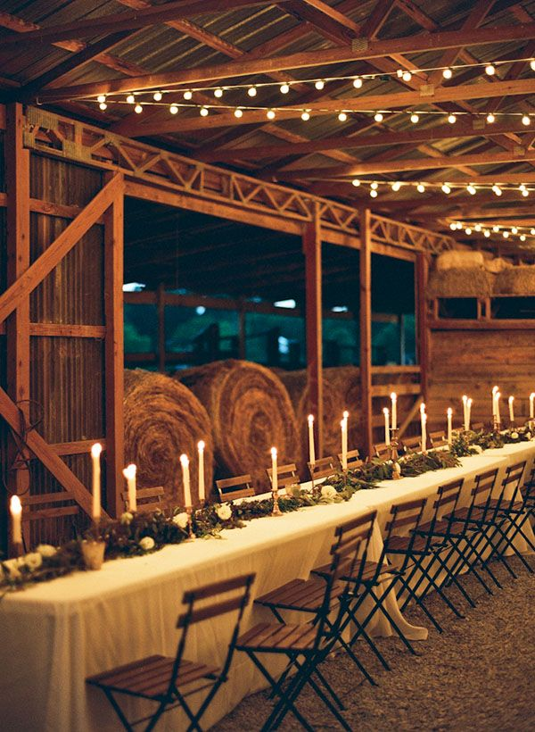 candles and garland on long farm table