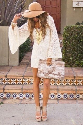 Boho hat and full mane tops off a lace Mandarin-sleeve mini dress with scoop neck and forever-legs. Add the stairway-to-heaven effect of nudey peep-toe wedges, and however long he had to wait for you to get ready? Screw the reservation.