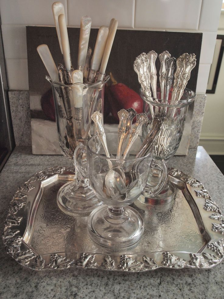 Use antique pattern glass celery vases, spooners and open sugars as a perfect way to display silverware on a buffet