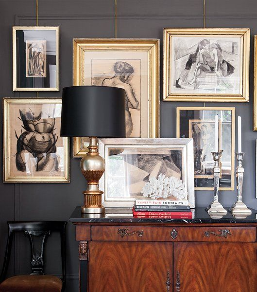 charcoal grey is the perfect back drop for these gorgeous gold-framed sketches..