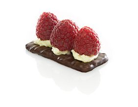 Easy snack idea!   Almond Thins enrobed with dark chocolate with light yellow ganache and Belgian raspberries