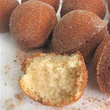 """Cinnamon Baked Doughnut Holes: King Arthur Flour..""""A basic cinnamon muffin batter is easily converted to baked doughnut holes, sweet little spheres of cinnamon-y cake doughnut. All you need is a doughnut hole pan, and this recipe.""""  i bet you could use a mini muffin tin, too."""