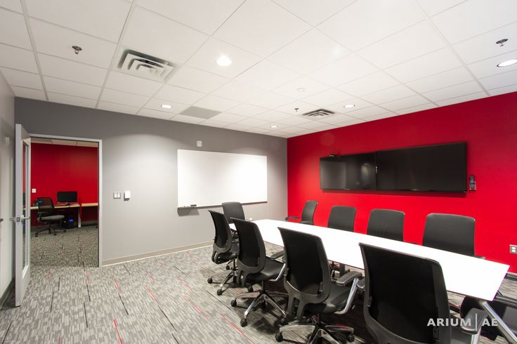 Small conference room in an office space with red accent