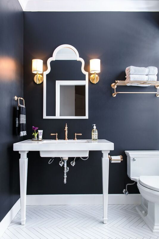 Navy bathroom with patterned flooring.