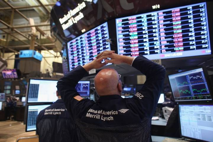 Investors piled back into stocks Wednesday morning in what's been one of the most volatile weeks for global stock markets in years.