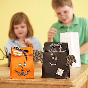 Need a supersimple kids' party craft? Make these treat bags the kids can take home after the party. Give the children a lunch-size sack in white, black, or orange, and let them use their imagination to create a skeleton-, bat-, spider-, or pumpkin-theme bag using paper cutouts, paint markers, googly eyes, chenille stems, and other crafts supplies.