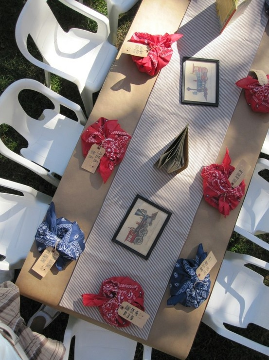 train party table- like photos as decorations