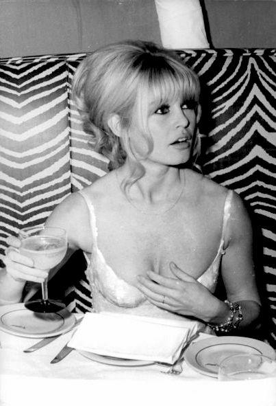 Brigitte Bardot sipping champagne at El Morocco, c. 1965