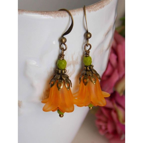 These Beautiful orange and green bell Lucite flowers have The perfect amount of contrast for your favorite Jeans or Legging. Czech glass beads adds the final touch. These a... #bell_earrings #blooming_earrings #brass_filigree_cap #czech_glass_beads #earrings #faerie_fairy_elf #floral_victorian #flower_earrings #jewelry #lucite_beads #orange_earrings #trumpet_flowers #victorian #victorian_earrings #vintage_dangle #vintage_style