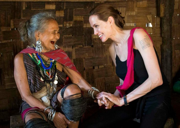 Angelina Jolie, special envoy of the United Nations High Commissioner for Refugees (UNHCR), visits Karenni refugee Baw Meh, 75, and Baw Meh'...