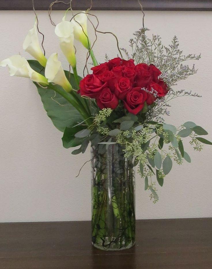 2 dozen roses and large white calla lilies Rose flower arrangement www.bloomsonbuckley.com
