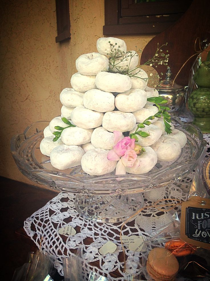 Powdered Donuts stacked nicely makes for a beautiful touch for the dessert table :)