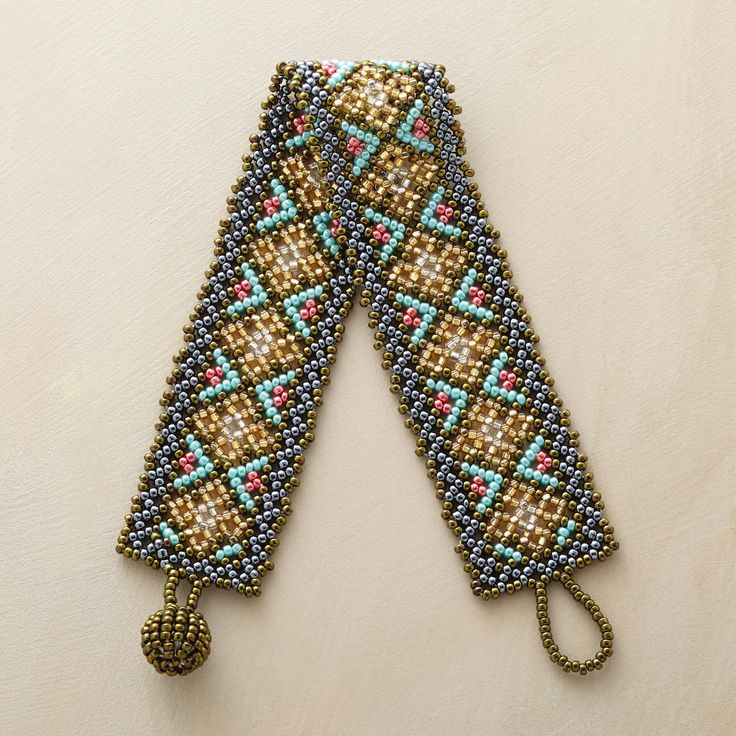 "BORDERLANDS BRACELET -- Handmade by native Huichol artists in the remote mountains of Mexico. This exquisite Huichol artisan beaded bracelet combines ancient tribal textile motifs with contemporary style. Exclusive. 7""L."