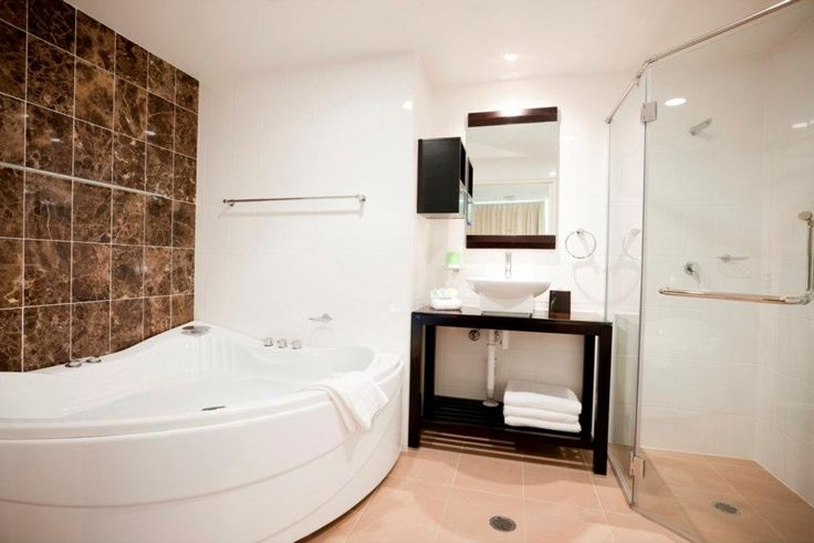 Ensuite bathroom with spa in both Studio Deluxe and three bedroom apartments.