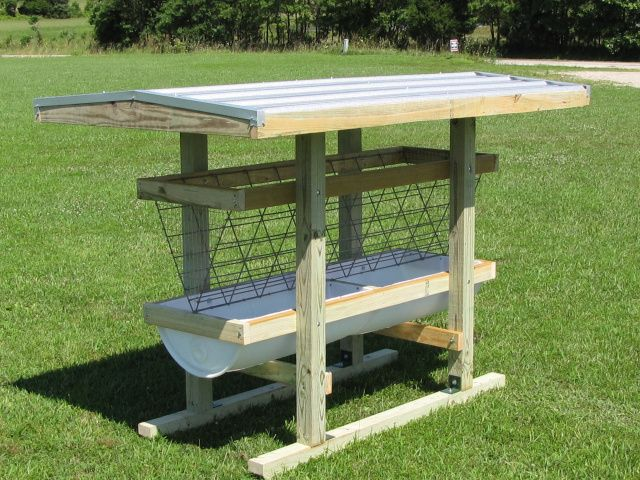 """Hay feeder.  Plastic tray and wire mesh """"v""""  Reduces the chance of hay falling down on the ground."""