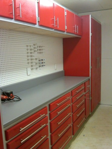 Garage Cabinets- Similar to our idea... red cabinets, grey counter top, black hook wall :)