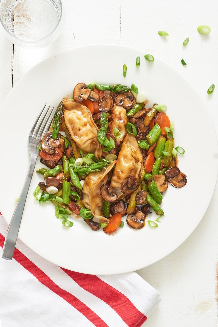 Potsticker Stir-Fry — Easy (potstickers from frozen.  Remove then add mushrooms, asparagus, carrots, ginger.  Return potstickers, and add sauce)