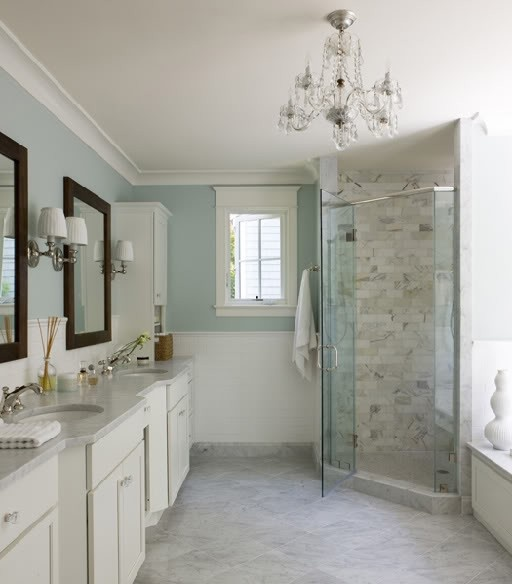 The Awesome Web Traditional bathroom with light blue walls painted in Benjamin Moore Palladian Blue marble floors and shower tiles Double sink marble counters and a touch