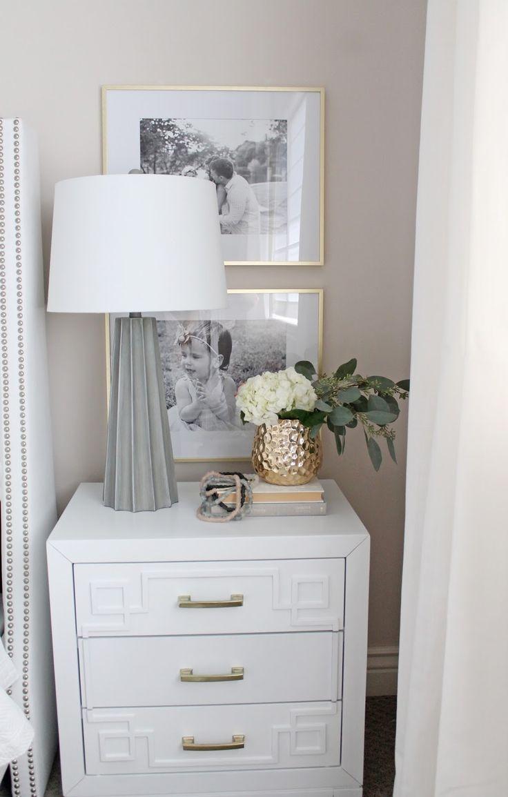 An elegant, serene master bedroom in white and gold