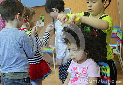 Children In Kindergarten Playing The Barber - Download From Over 42 Million High Quality Stock Photos, Images, Vectors. Sign up for FREE today. Image: 70345926