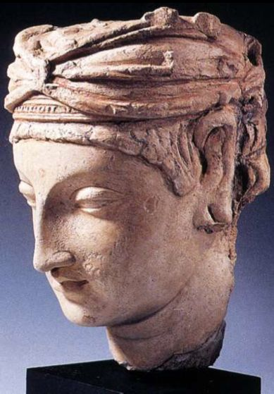 A Male Head,  Gandhara, 4th-5th centuries C.E., stucco, painted, H: 26 cm. MIK collection I. 4871