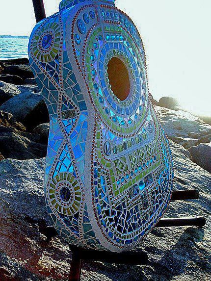 An artist who takes a very different approach to turning musical instruments into art is American artist Lisa Calabro of Crooked Moon Studio in Warwick, Rhode Island. Lisa has transformed old instruments into artworks by mosaicing them. See more of her lovely mosaics on her website http://crookedmoonstudio.com