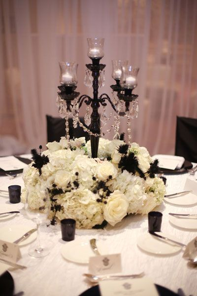 centerpiece with candelabra - change flowers to red or dark purple for a vampire theme. In love