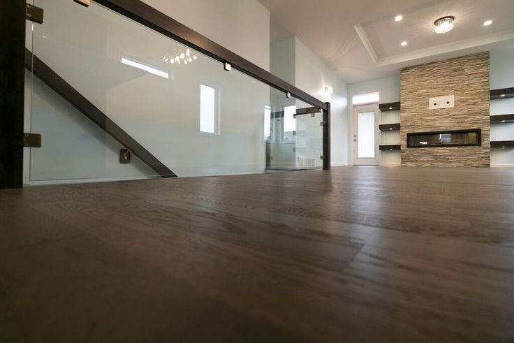 Glass panel rail helps this area feel even more open #spaciousliving #harmonyhome