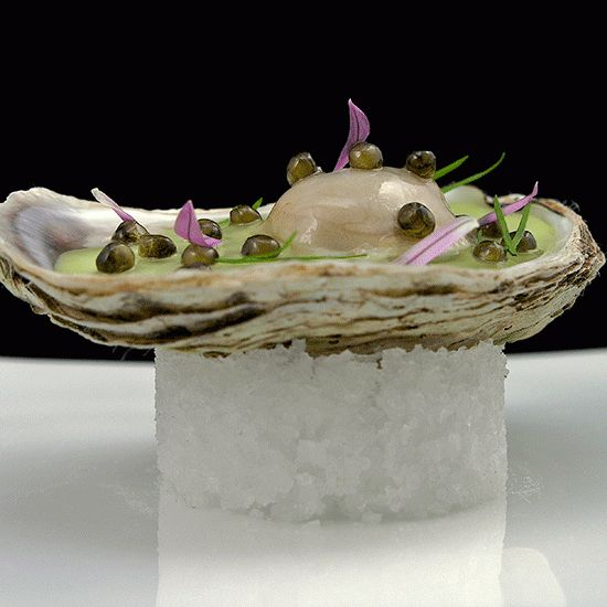 extravagance (caviar pearls, oyster gelée) with classic French comfort food (a vichyssoise of potatoes and leeks)—all inside an oyster. #food