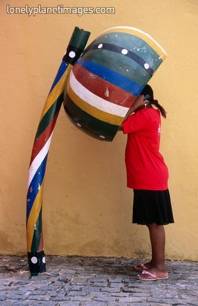 Telephone booth in shape of sounding gourd of berimbau (capoeira instrument), By Rick Gerharter - Salvador, Bahia, Brazil.