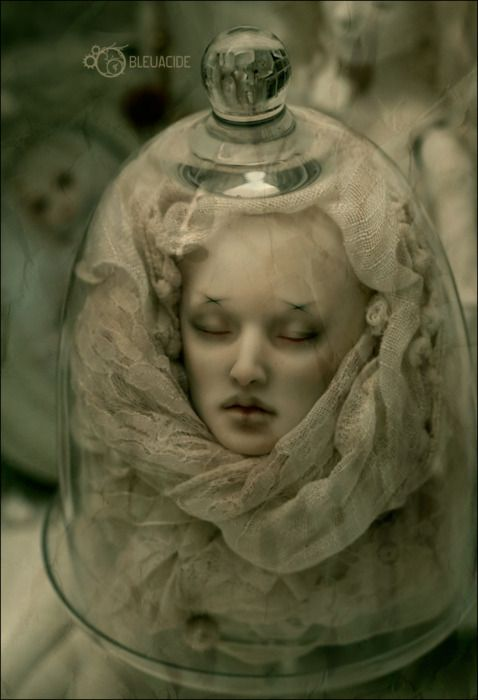 Halloween decor ideas. from Amanda Alexander on Creepily Wonderful. Doll head wrapped