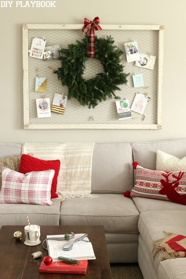 Every year we use a large chicken wire frame and clothespins to hang Christmas cards in the family room. Love the addition of a fresh wreath too!