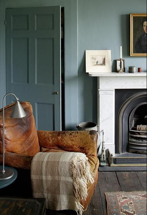 Ahh lovely comfy leather armchair, lovely fireplace & love the colour scheme. Very relaxing.