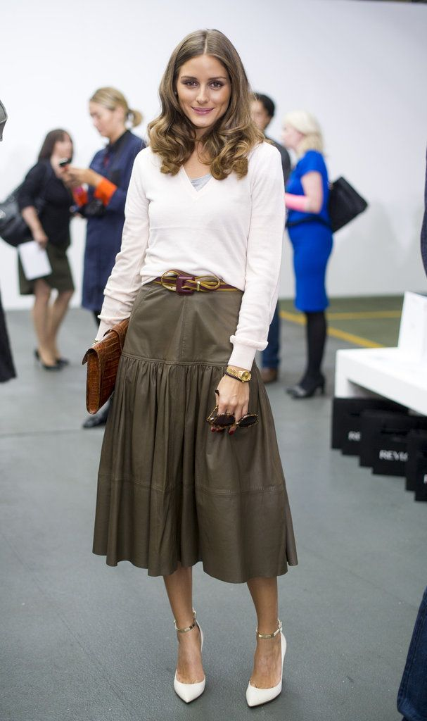 Olivia Palermo played ladylike with a contemporary angle at Antonio Berardi in London. In a Reiss top and skirt, she added in her quintessential dose of accessories, like a slim belt, Hermès clutch, and Valentino heels, to give the separates her own twist at Fashion Week 2012.