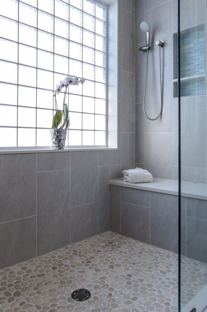 Pebble flooring and a gorgeous Caesarstone shower bench make this our dream shower!