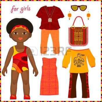 Puppe aus Papier mit einem Satz von bunte ethnische Kleidung. Nettes kleines afrikanisches M�dchen. Isoliert auf wei�em Hintergrund photo