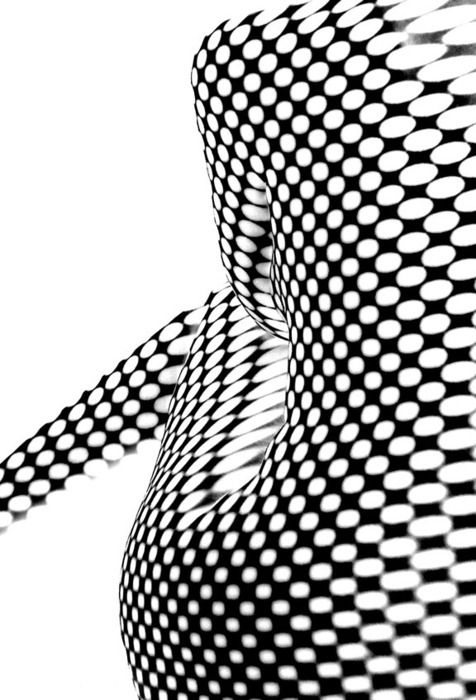 12.2 This design use black and white pattern forming the shape of a woman. High contrast, simple but great!
