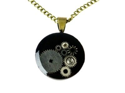 Necklace with pendant made ​​of elements of the watch mechanism flooded with resin.