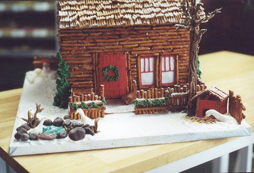 I absolutely love this little log cabin. With little pretzels, the outside must have taken a long time. I also really love the roof, it looks like golden grahams.