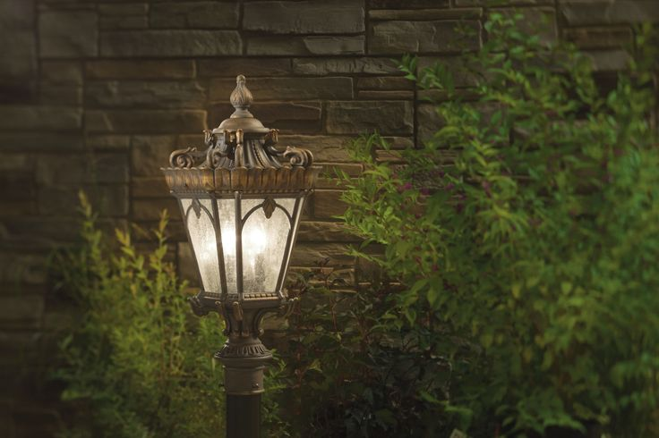 Kichler Tournai: These ornate outdoor lights are handmade from sturdy cast aluminum to give you hardy lights that can withstand the elements. Clear seeded glass panes make the light more dramatic. Choose from Londonderry finish (rustic bronze) or black. Tournai comes in outdoor wall lights, outdoor ceiling mounts, outdoor post lights and outdoor hanging lights.