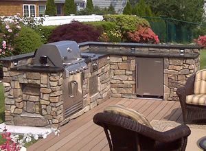 """I like the stone exterior with a black / charcoal granite counter.  This is the construction basic that I'm thinking of for your space.  Note plugs and 42"""" wall-cap on one side and bar on the other..."""