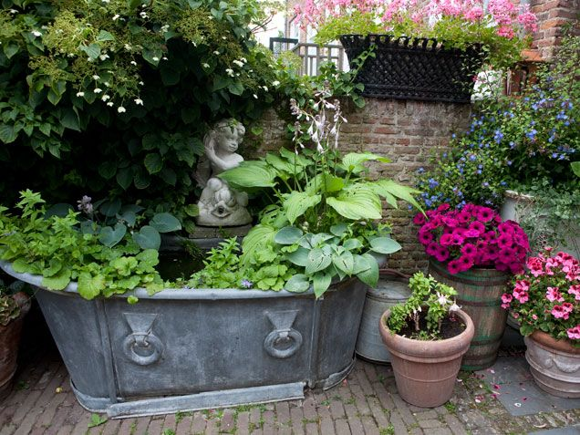 These incredible gardens will inspire you to get outdoors and get your hands dirty. Whether you have a small space or a sprawling plot, w...: Gardens Ideas, Container Gardens, Gardens Decor, Backyard Landscape, Outdoor Living Spaces, Small Ponds, Landscape Ideas, Front Porches,  Flowerpot