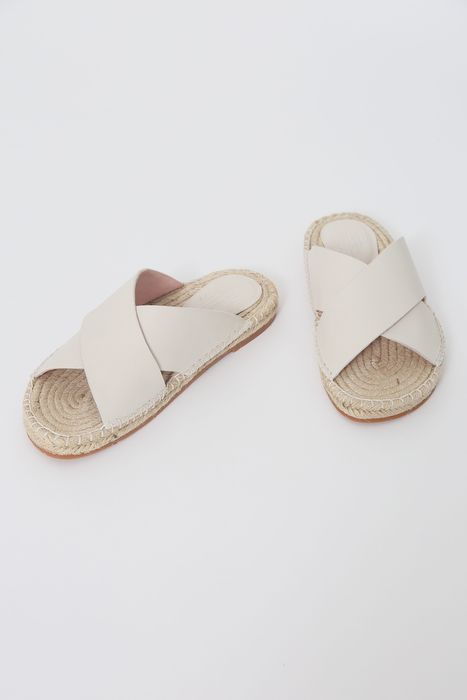 Smooth leather straps are criss-crossed over a braided jute footbed for the ultimate in comfort and ...