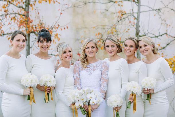 Long sleeve white bridesmaid dresses | SouthBound Bride | http://www.southboundbride.com/chic-white-winter-wedding-at-rockhaven-by-kristi-agier-ashton-nic | Kristi Agier