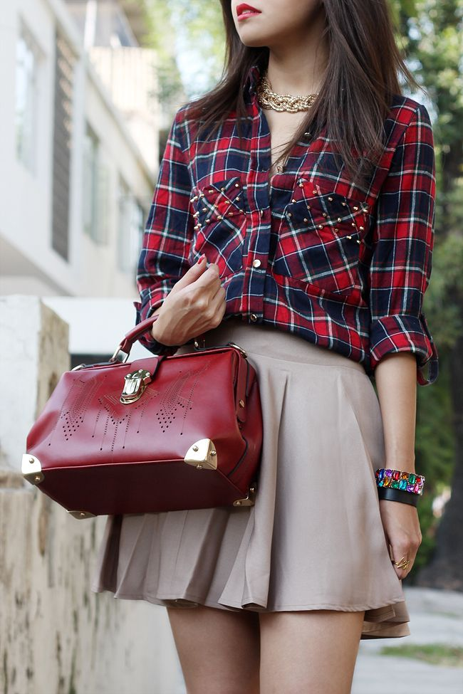 Button Down plaid collared blouse with studded accent on pocket along with simple flowing khaki skirt