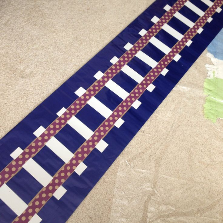 Railroad Track Table Runner Made Out Of Wring Paper And Card Stock