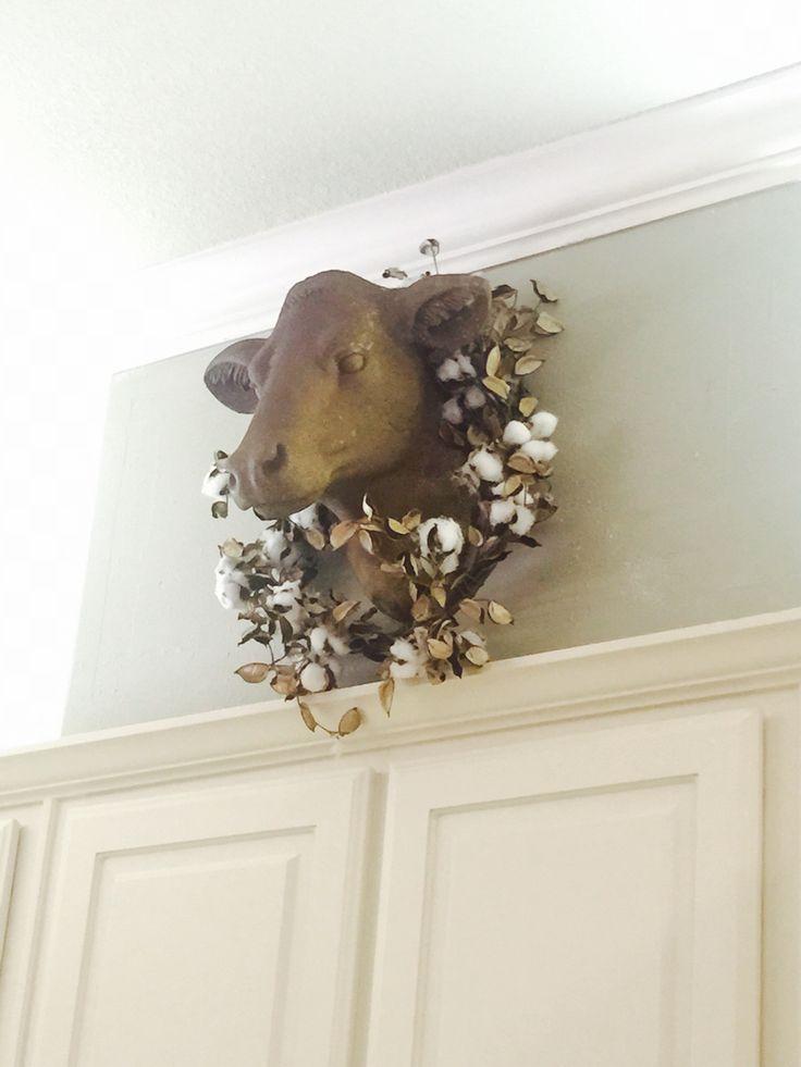 Cow head bust in cream kitchen
