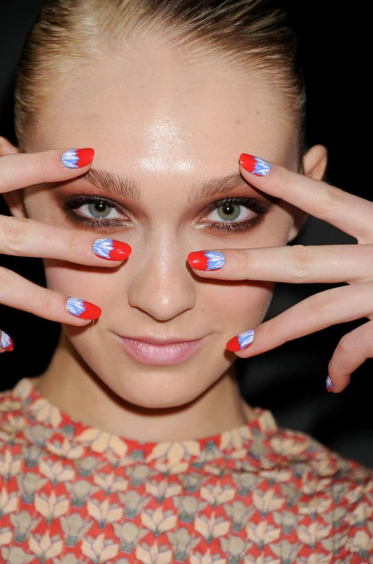 """To get the look:  """"Flirty Flower"""" was created with two coats of bold red CND Colour in Flashpoint with hand detailed ferns using CND Colours in Brilliant White and Anchor Blue. - RLB"""