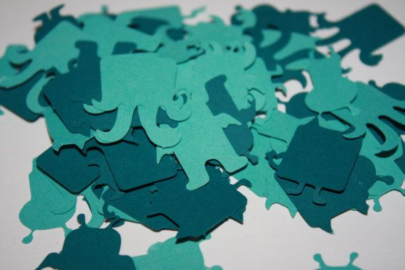 Teal Mini Monster Die Cut Confetti Table Decor 200 pieces these are kind of adorable.